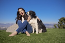 Sunny Leone In Tight Jeans Playing With Her Puppies HQ x 74
