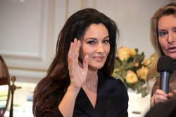 Monica Bellucci - at a Dolce & Gabbana store in Milan 1/26/13