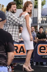 Maria Menounos Wearing a Tight White Dress on the Extra Set in Hollywood on September 10, 2013