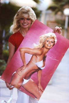 LONI ANDERSON holding a poster of herself in a bikini