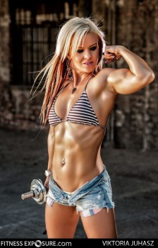 Provocative female bodybuilder shows amazing abs glute and quad striations